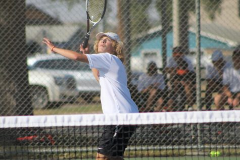 Junior Colby Nehring going in for a hit (photo credits: Essence Gleplay and Anna Isom, WHS journalism)